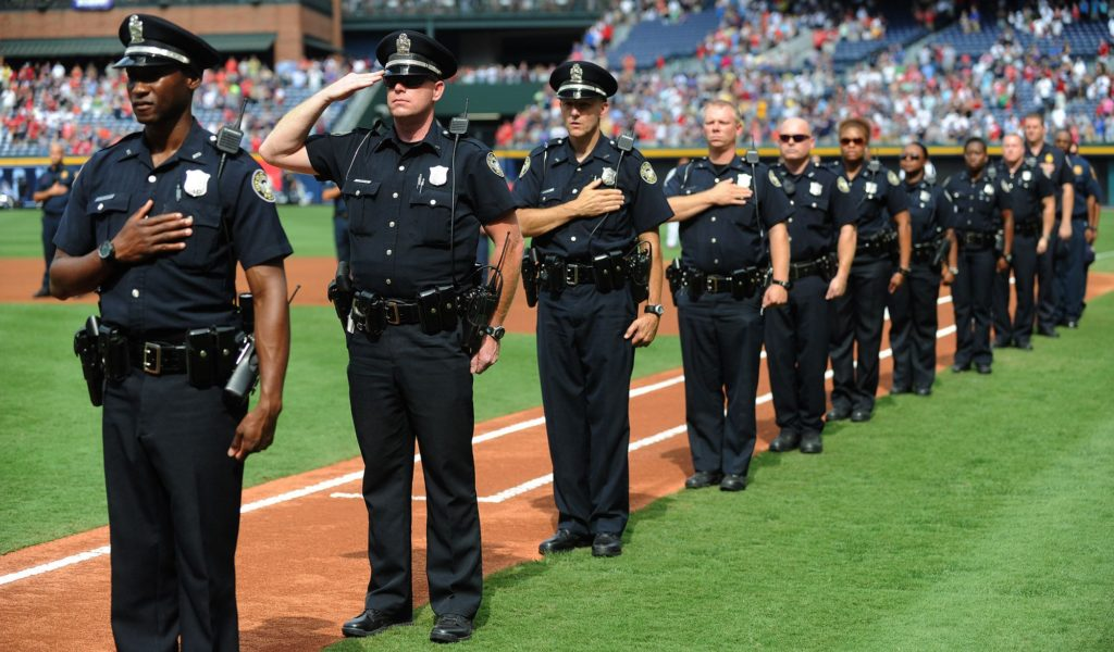 100911 -Atlanta  -Members of the Atlanta Police Department stand near the first base line during the  Atlanta Braves pregame ceremony to honor those who died on September 11th during the Atlanta Braves vs St. Louis Cardinals game at Turner Field on Saturday Sept 11,2010.  Johnny Crawford Jcrawford@ajc.com